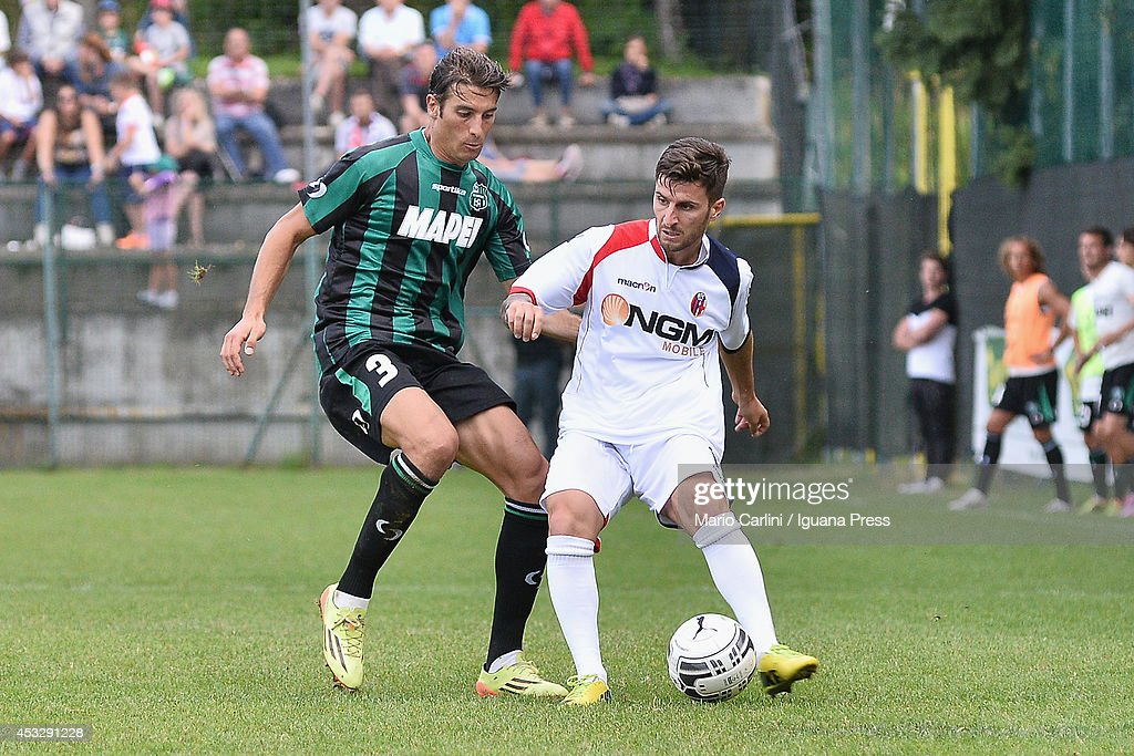 Luca Giannone # 13 of Bologna FC ( R ) competes the ball with <a gi-track='captionPersonalityLinkClicked' href=/galleries/search?phrase=Federico+Peluso&family=editorial&specificpeople=6336600 ng-click='$event.stopPropagation()'>Federico Peluso</a> # 3 of US Sassuolo ( L ) during the pre-season frienldy match between FC Bologna and US Sassuolo on August 6, 2014 in Modena, Italy.
