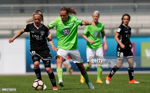 Luca Graf of FF USV Jena is challenged by Emily van Egmond of VfL Wolfsburg during the Allianz Women's Bundesliga match between VfL Wolfsburg and FF...