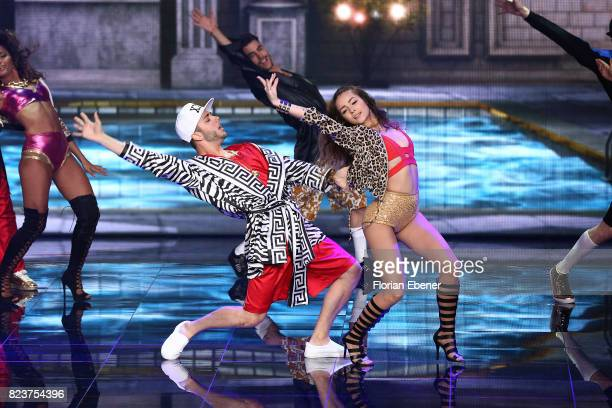 Luca Haenni and Prince Damien perform on stage during the 1st show of the television competition 'Dance Dance Dance' on July 12 2017 in Cologne...