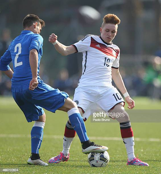 Luca Herrmann of Germany competes for the ball with Edoardo Bianchi of Italy during the international friendly match between U16 Italy and U16...