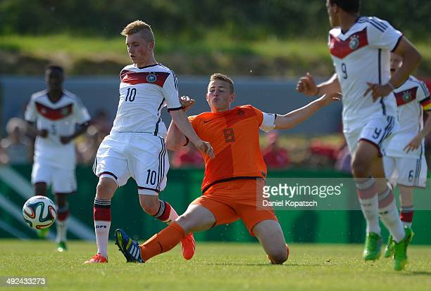 Luca Herrmann of Germany is challenged by Matthijs De Ligt of the Netherlands during the international friendly U15 match between Germany and...