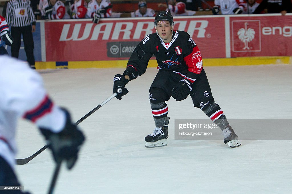 Luca Knutti of Gotteron on forechecking during the group stage match between Fribourg-Gotteron and Eisbaeren Berlin on August 23, 2014 in Fribourg, Switzerland.