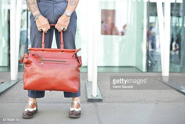 Luca Lanzoni poses wearing Progetto Fede bag and Scarti Lab pants on June 20 2015 in Milan Italy