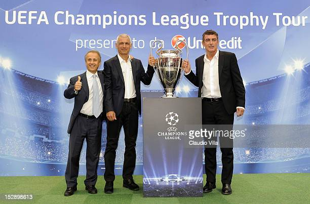 Luca Lorenzi Fabrizio Ravanelli and Gianluca Pagliuca pose with the trophy during the UEFA Champions League Trophy Tour 2012/13 on September 28 2012...