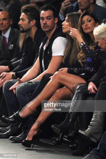 Luca Marin and Belen Rodriguez attend the John Richmond show as part of Milan Fashion Week Menswear Autumn/Winter 2013 on January 14 2013 in Milan...