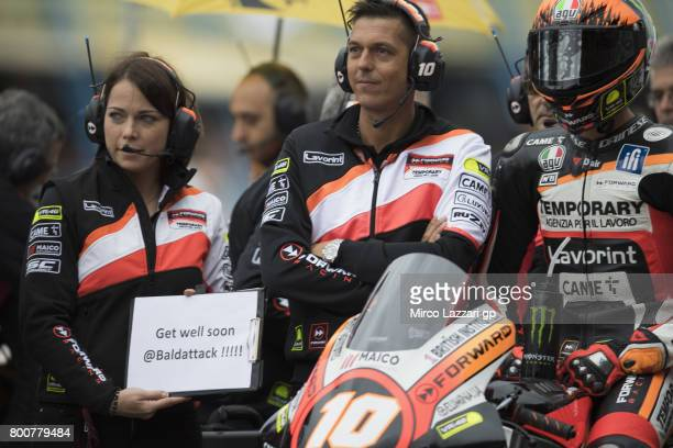 Luca Marini of Italy and Forward Racing Team and team support Lorenzo Baldassarri of Italy and prepares to start on the grid during the Moto2 Race...