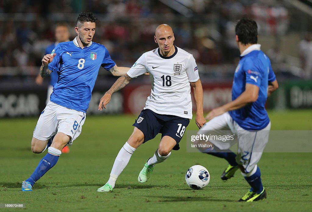 Luca Marronei of Italy in action with <a gi-track='captionPersonalityLinkClicked' href=/galleries/search?phrase=Jonjo+Shelvey&family=editorial&specificpeople=4940315 ng-click='$event.stopPropagation()'>Jonjo Shelvey</a> of England during the UEFA European U21 Championships, Group A match between England and Italy at the Bloomfield Stadium on June 5, 2013 in Tel Aviv, Israel.