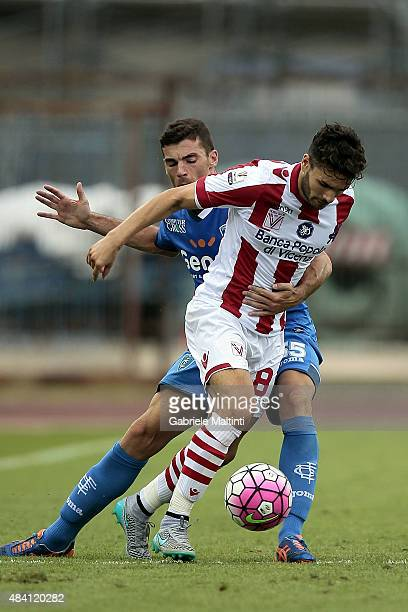 Luca Martinelli of Empoli FC battles for the ball with Antonio Cinelli of Vicenza Calcio during the TIM Cup match between Empoli FC and Vicenza...