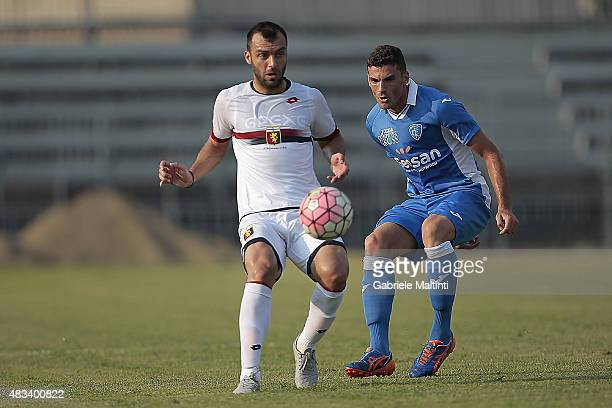 Luca Martinelli of Empoli FC battles for the ball with Goran Pandev of Genoa CFC during the preseason friendly match between Empoli FC and Genoa CFC...