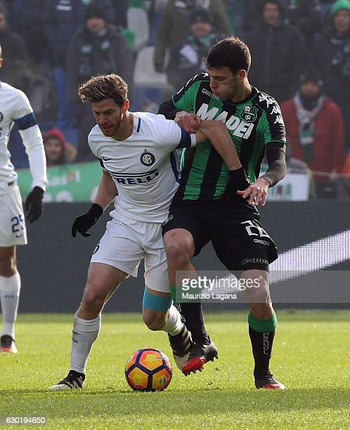 Luca Mazziitelli of Sassuolo competes for the ball with Cristian Ansaldi of Inter during the Serie A match between US Sassuolo and FC Internazionale...