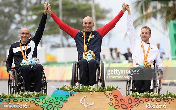Luca Mazzone of Italy Gold medalist William Groulx of the United States and Bronze medalist Tobias Fankhauser of Switzerland celebrate on the podium...