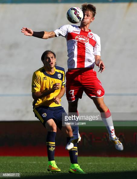 Luca Miracoli of AS Varese is challenged by Gabriel Alejandro Paletta of Parma during the preseason friendly match between AS Varese and FC Parma at...
