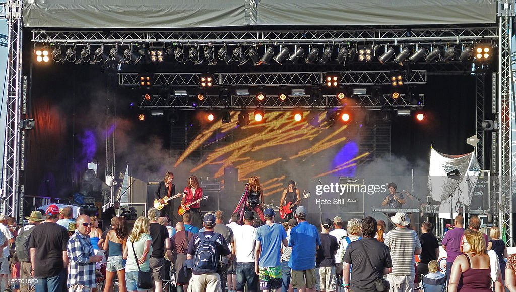 Luca Mommi, Davide Pola, Renzo D'Aprano, Massimo Conti and Gian Marco Benvenuti of italian Aerosmith tribute band Big Ones perform on stage at the Silverstone Classic at Silverstone on July 25, 2014 in Northampton, United Kingdom.