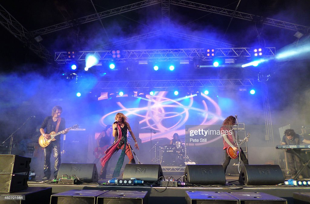Luca Mommi, Massimo Conti, Renzo D'Aprano, Mauro Munzi, Davide Pola and Gian Marco Benvenuti of italian Aerosmith tribute band Big Ones performs on stage at Silverstone Classic at Silverstone on July 25, 2014 in Northampton, United Kingdom.