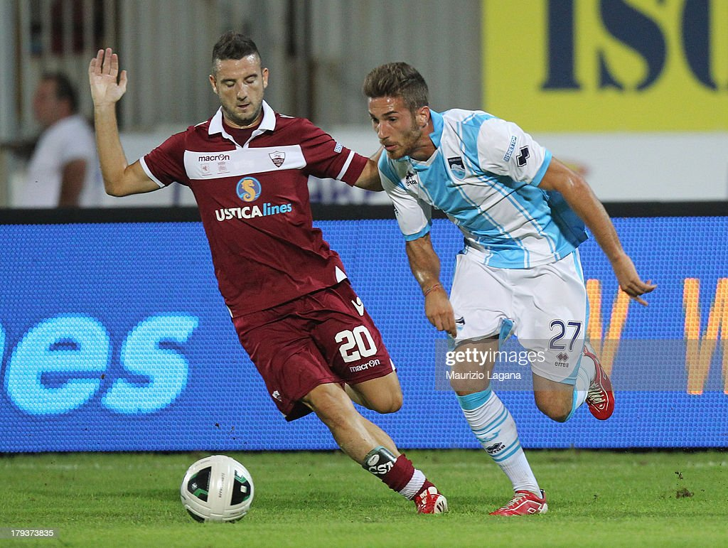 Luca Nizzetto (L) of Trapani competes for the ball with Antonino Ragusa of Pescara during the Serie B match between Trapani Calcio and Pescara Calcio at Stadio Provinciale on September 2, 2013 in Trapani, Italy.
