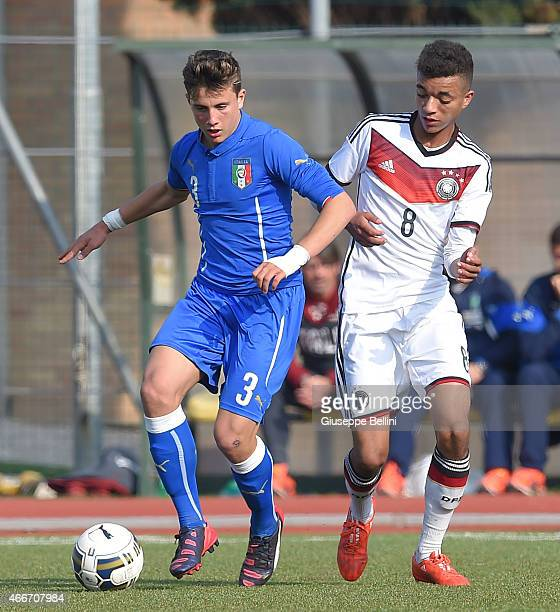 Luca Pellegrini of Italy and Timothy Tillman of Germany in action during the international friendly match between U16 Italy and U16 Germany on March...