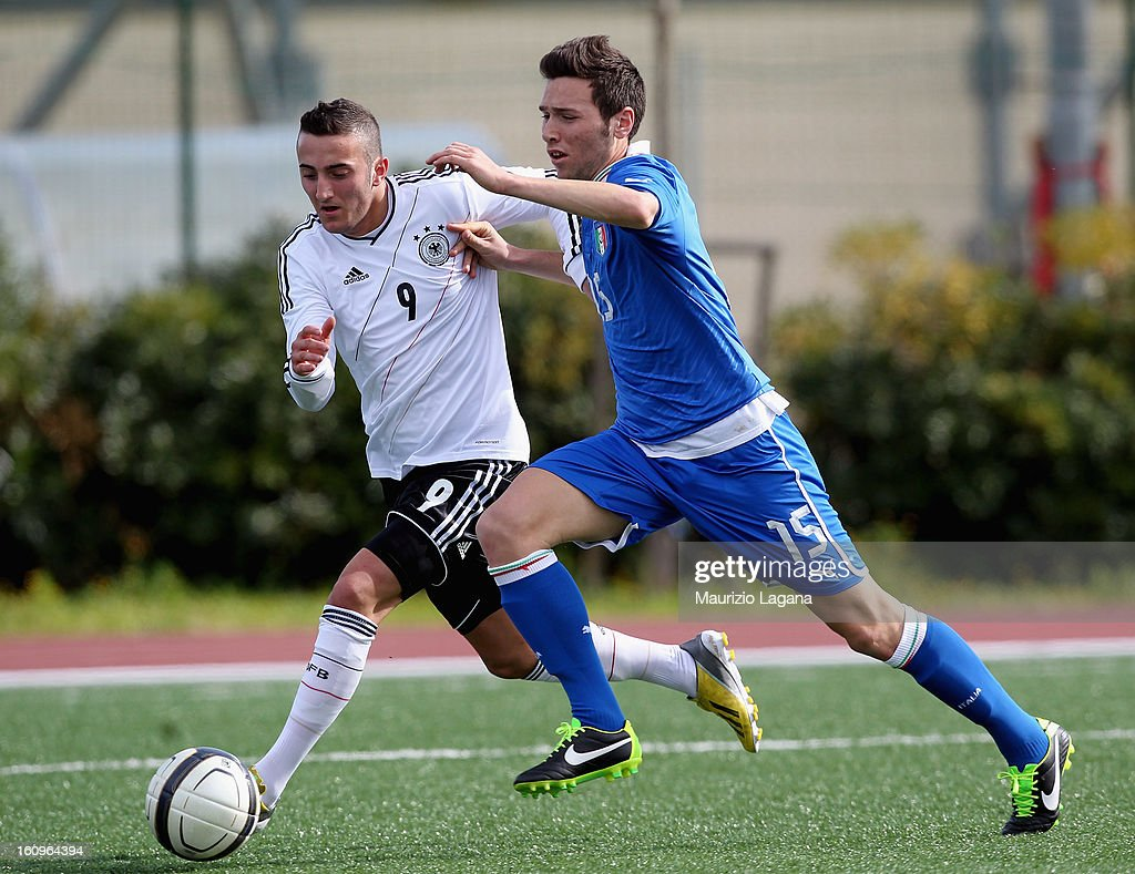 Luca Piana (R) of Italy competes for the ball with <a gi-track='captionPersonalityLinkClicked' href=/galleries/search?phrase=Samed+Yesil&family=editorial&specificpeople=5945598 ng-click='$event.stopPropagation()'>Samed Yesil</a> of Germany during Under 19 International Friendly match between Italy and Germany at Stadio Comunale San Pio on February 6, 2013 in Santo Spirito near Bari, Italy.