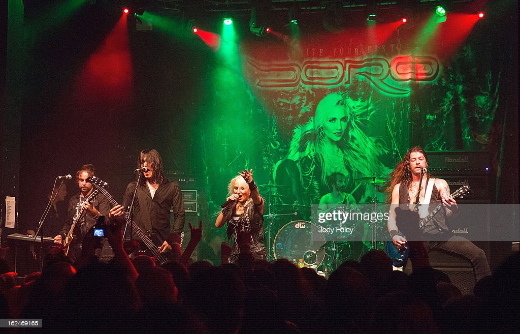 Luca Princiotta, Nick Douglas, Doro Pesch, Johnny Dee, and Bas Maas of the Hardrock band, DORO performs in concert at Mojoes on February 13, 2013 in Joliet, Illinois.