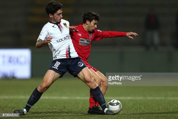 Luca Ricci of AS Gubbio 1910 compete for the ball with Lorenzo De Grazia of Teramo Calcio 1913 during the Lega Pro 17/18 group B match between Teramo...