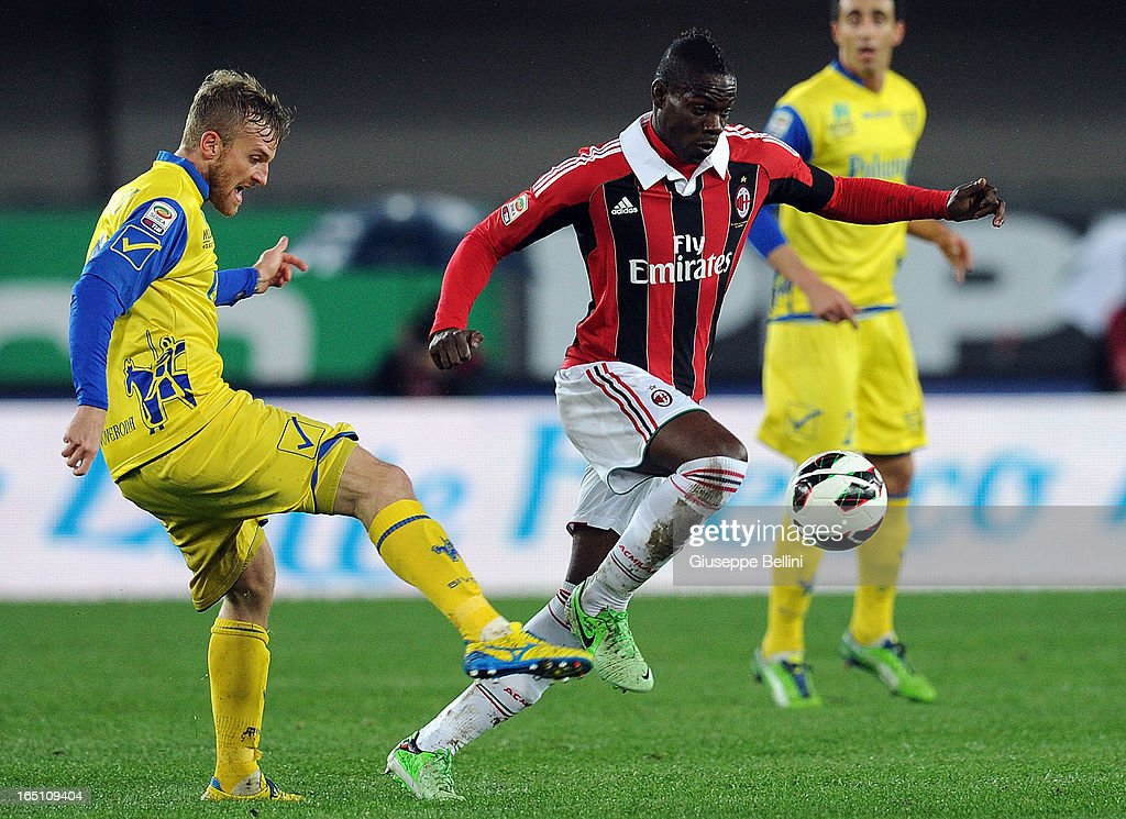 Luca Rigoni of Chievo in action against Mario Balotelli of Milan during the Serie A match between AC Chievo Verona and AC Milan at Stadio Marc'Antonio Bentegodi on March 30, 2013 in Verona, Italy.
