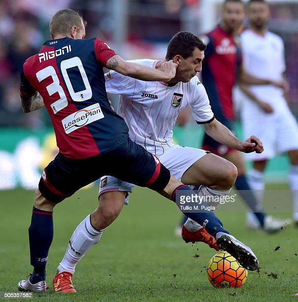 Luca Rigoni of Genoa and Mato Jajalo of Palermo compete for the ball during the Serie A match between Genoa CFC and US Citta di Palermo at Stadio...