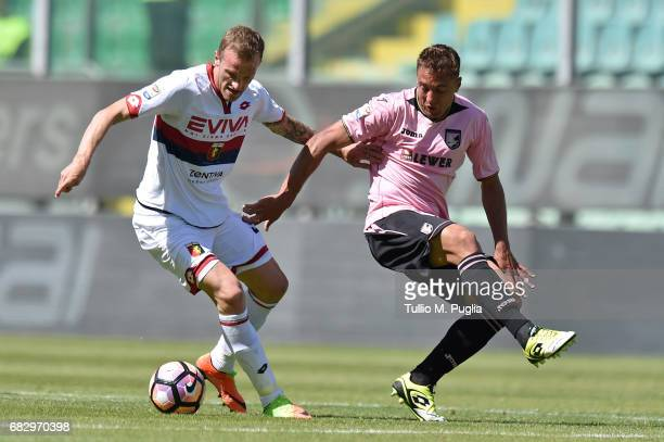 Luca Rigoni of Genoa and Thiago Cionek of Palermo compete for the ball during the Serie A match between US Citta di Palermo and Genoa CFC at Stadio...