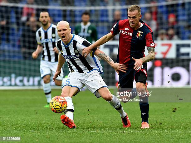 Luca Rigoni of Genoa CFC competes for the ball with Emil Hallfredsson during the Serie A match between Genoa CFC and Udinese Calcio at Stadio Luigi...