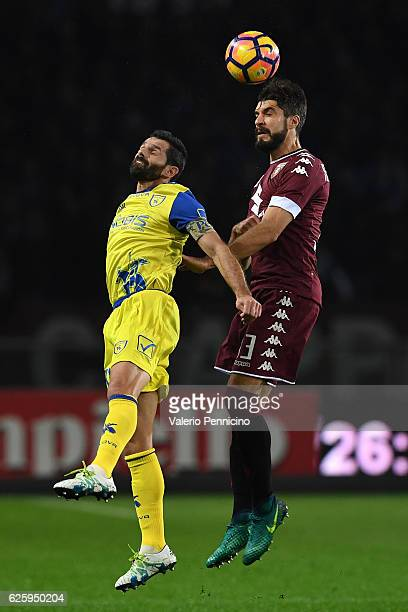 Luca Rossettini of FC Torino goes up with Sergio Pellissier of AC ChievoVerona during the Serie A match between FC Torino and AC ChievoVerona at...