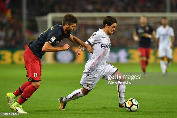 Luca Rossettini of Genoa CFC competes with Simone Verdi of Bologna FC during the Serie A match between Genoa CFC and Bologna FC at Stadio Luigi...