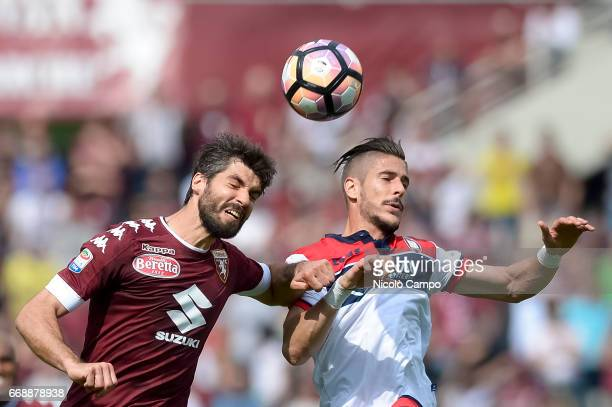 Luca Rossettini of Torino FC and Diego Falcinelli of FC Crotone compete for a header during the Serie A football match between Torino FC and FC...