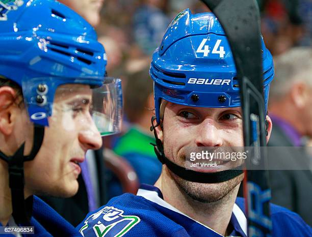 Luca Sbisa and Erik Gudbranson of the Vancouver Canucks smile during their NHL game against the Toronto Maple Leafs at Rogers Arena December 3 2016...