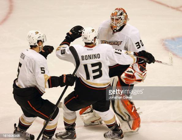 Luca Sbisa and Nick Bonino of the Anaheim Ducks celebrate with Viktor Fasth after a win against the Chicago Blackhawks at the United Center on...