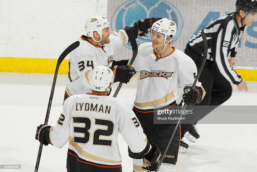 <a gi-track='captionPersonalityLinkClicked' href=/galleries/search?phrase=Luca+Sbisa&family=editorial&specificpeople=4893043 ng-click='$event.stopPropagation()'>Luca Sbisa</a> #5 celebrates with his Anaheim Ducks teammates <a gi-track='captionPersonalityLinkClicked' href=/galleries/search?phrase=Daniel+Winnik&family=editorial&specificpeople=2529214 ng-click='$event.stopPropagation()'>Daniel Winnik</a> #34 and <a gi-track='captionPersonalityLinkClicked' href=/galleries/search?phrase=Toni+Lydman&family=editorial&specificpeople=204145 ng-click='$event.stopPropagation()'>Toni Lydman</a> #32 after scoring a goal against the Minnesota Wild during the game on March 12, 2013 at the Xcel Energy Center in Saint Paul, Minnesota.