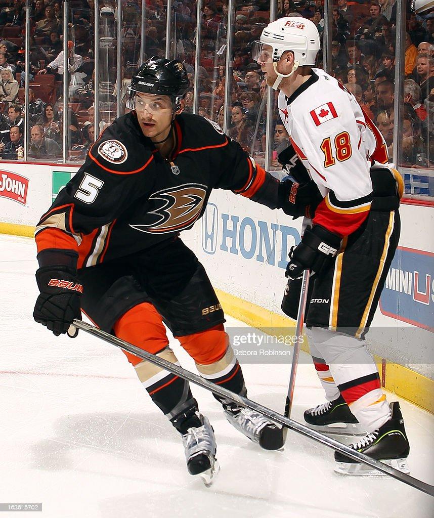 Luca Sbisa #5 of the Anaheim Ducks battles for position against Matt Stajan #18 of the Calgary Flames on March 8, 2013 at Honda Center in Anaheim, California.