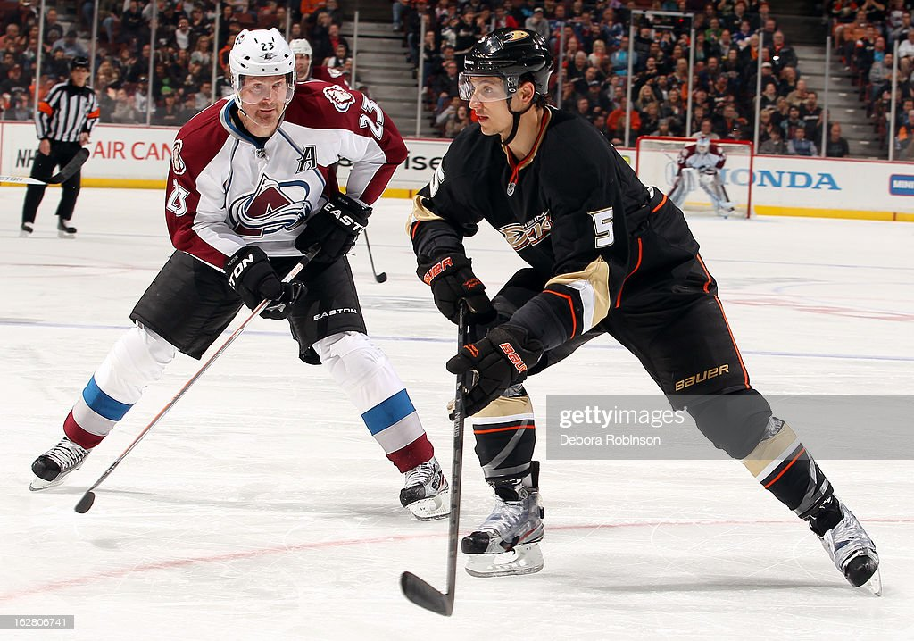 Luca Sbisa #5 of the Anaheim Ducks battles for position against Milan Hejduk #23 of the Colorado Avalanche on February 24, 2013 at Honda Center in Anaheim, California.