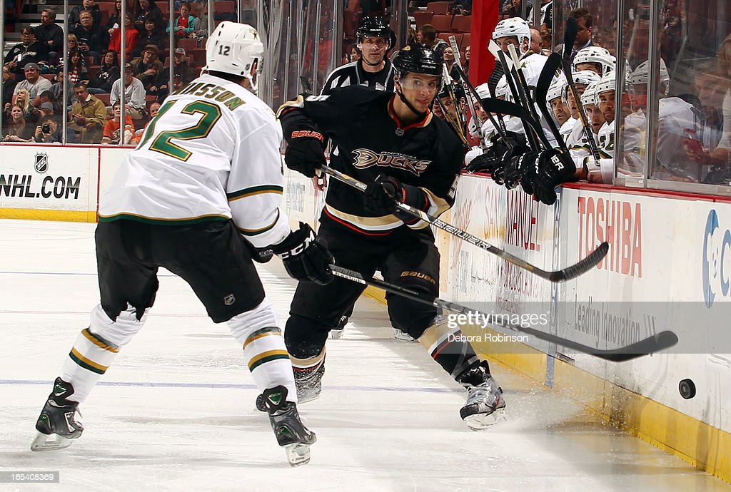 Luca Sbisa #5 of the Anaheim Ducks passes the puck past Alex Chiasson #12 of the Dallas Stars on April 3, 2013 at Honda Center in Anaheim, California.