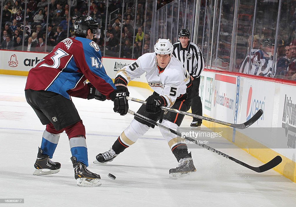 Luca Sbisa #5 of the Anaheim Ducks passes the puck past Michael Sgarbossa #43 of the Colorado Avalanche follows at the Pepsi Center on February 6, 2013 in Denver, Colorado.