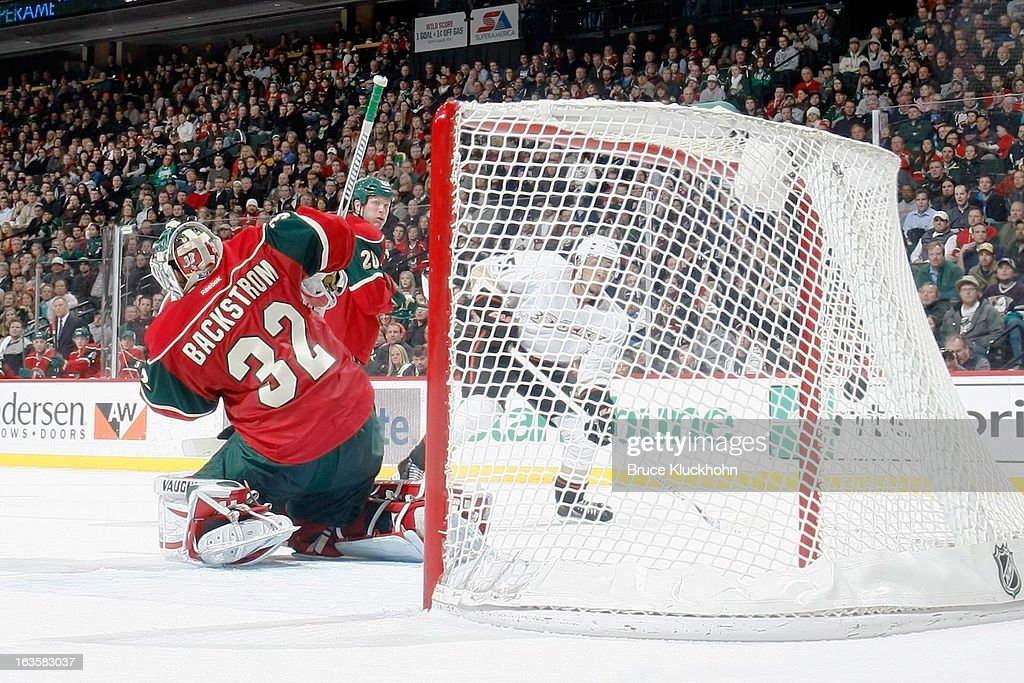 <a gi-track='captionPersonalityLinkClicked' href=/galleries/search?phrase=Luca+Sbisa&family=editorial&specificpeople=4893043 ng-click='$event.stopPropagation()'>Luca Sbisa</a> #5 of the Anaheim Ducks scores a goal against goalie Niklas Backstrom #32 of the Minnesota Wild during the game on March 12, 2013 at the Xcel Energy Center in Saint Paul, Minnesota.