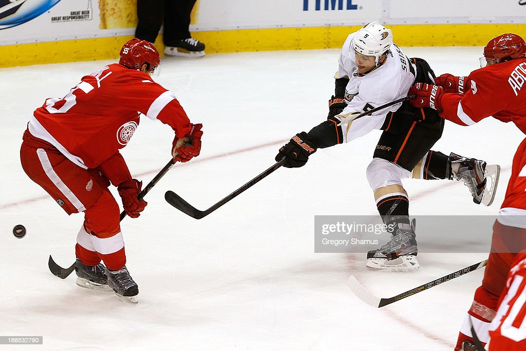 <a gi-track='captionPersonalityLinkClicked' href=/galleries/search?phrase=Luca+Sbisa&family=editorial&specificpeople=4893043 ng-click='$event.stopPropagation()'>Luca Sbisa</a> #5 of the Anaheim Ducks takes a second-period shot between <a gi-track='captionPersonalityLinkClicked' href=/galleries/search?phrase=Niklas+Kronwall&family=editorial&specificpeople=220826 ng-click='$event.stopPropagation()'>Niklas Kronwall</a> #55 and <a gi-track='captionPersonalityLinkClicked' href=/galleries/search?phrase=Justin+Abdelkader&family=editorial&specificpeople=2271858 ng-click='$event.stopPropagation()'>Justin Abdelkader</a> #8 of the Detroit Red Wings in Game Six of the Western Conference Quarterfinals during the 2013 NHL Stanley Cup Playoffs at Joe Louis Arena on May 10, 2013 in Detroit, Michigan.