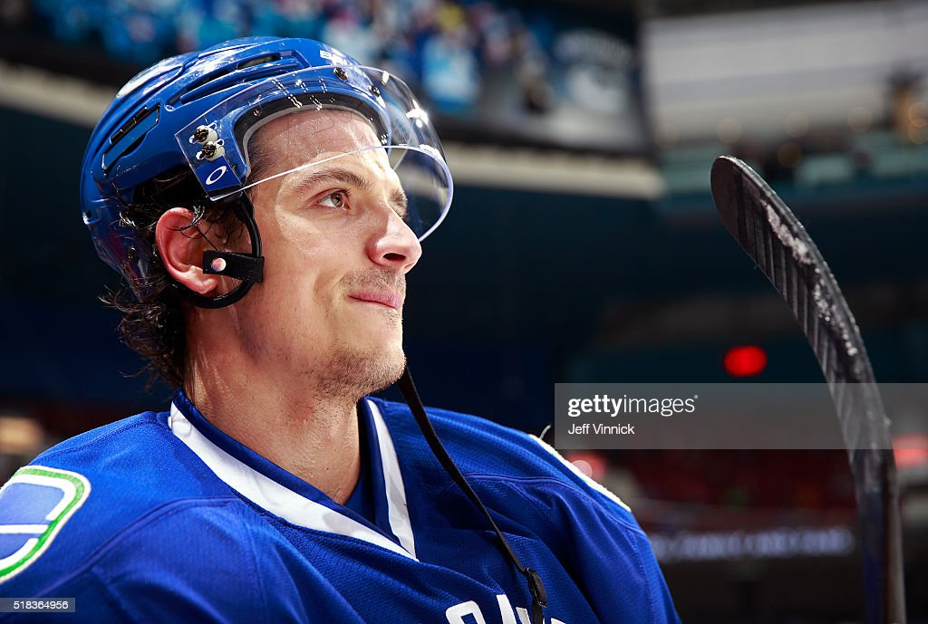 Luca Sbisa of the Vancouver Canucks looks on from the bench during their NHL game against the Arizona Coyotes at Rogers Arena March 9 2016 in...
