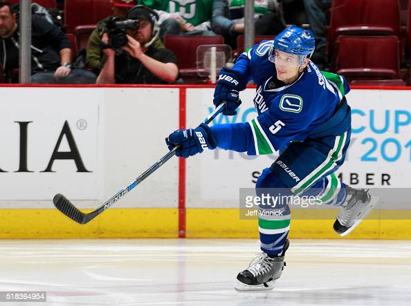 Luca Sbisa of the Vancouver Canucks passes the puck up ice during their NHL game against the Arizona Coyotes at Rogers Arena March 9 2016 in...