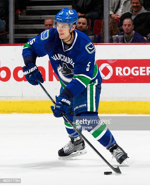 Luca Sbisa of the Vancouver Canucks skates up ice with the puck during their NHL game against the Florida Panthers at Rogers Arena January 8 2015 in...