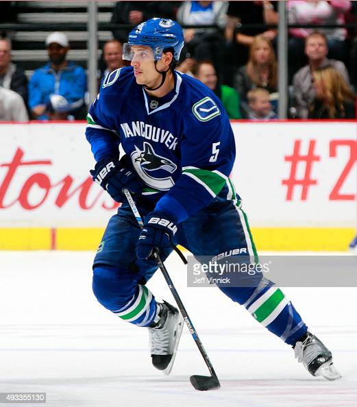 Luca Sbisa of the Vancouver Canucks skates up ice with the puck during their NHL game against the Edmonton Oilers at Rogers Arena October 18 2015 in...