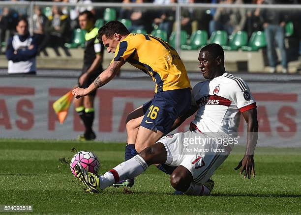 Luca Siligardi of Hella Verona competes for the ball with Cristian Zapata of AC Milan during the Serie A match between Hellas Verona FC and AC Milan...