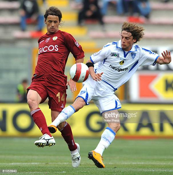 Luca Tognozzi of Reggina and Simone Marchisio of Empoli in action during the Serie A match between Reggina and Empoli at the Stadio Oreste Granillo...