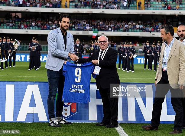 Luca Toni is presented with a shirt by President of the FIGC Carlo Tavecchio following his retirement from professional football prior to the...