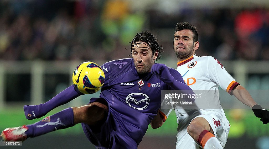 Luca Toni of ACF Fiorentina fights for the ball with Castan of AS Roma during the TIM cup match between ACF Fiorentina and AS Roma at Artemio Franchi on January 16, 2013 in Florence, Italy.