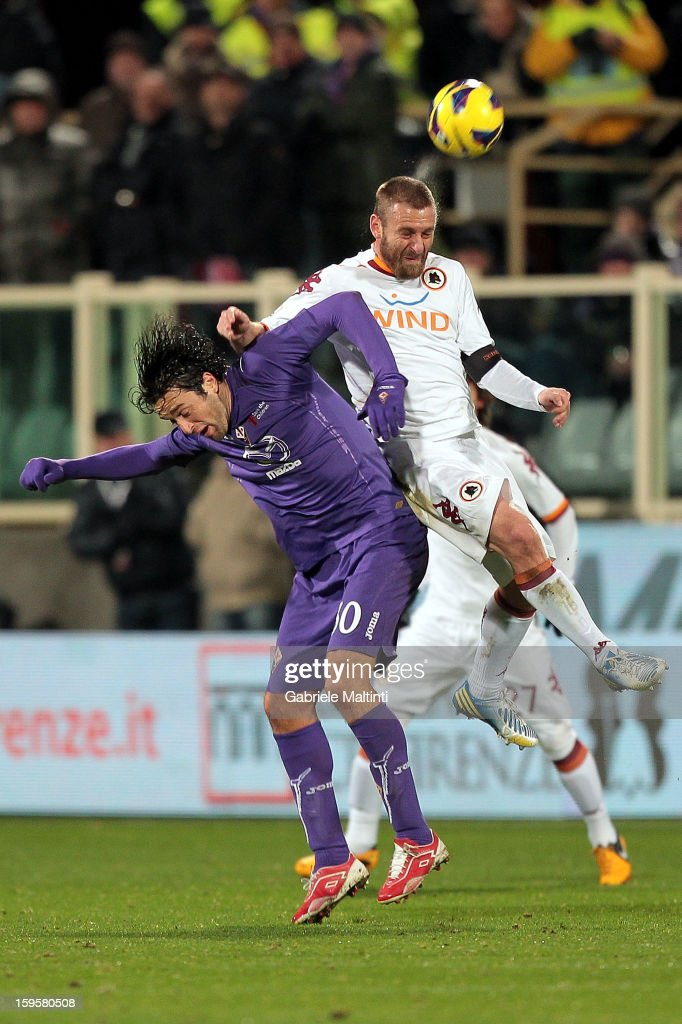 <a gi-track='captionPersonalityLinkClicked' href=/galleries/search?phrase=Luca+Toni&family=editorial&specificpeople=453307 ng-click='$event.stopPropagation()'>Luca Toni</a> of ACF Fiorentina fights for the ball with <a gi-track='captionPersonalityLinkClicked' href=/galleries/search?phrase=Daniele+De+Rossi&family=editorial&specificpeople=233652 ng-click='$event.stopPropagation()'>Daniele De Rossi</a> of AS Roma during the TIM cup match between ACF Fiorentina and AS Roma at Artemio Franchi on January 16, 2013 in Florence, Italy.