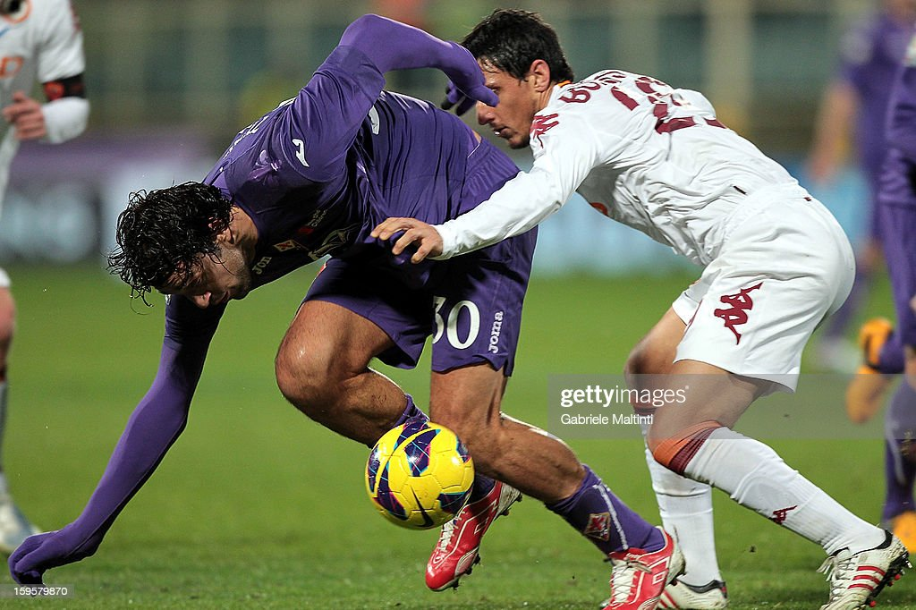 Luca Toni of ACF Fiorentina fights for the ball with Nicolas Burdisso of AS Roma during the TIM cup match between ACF Fiorentina and AS Roma at Artemio Franchi on January 16, 2013 in Florence, Italy.