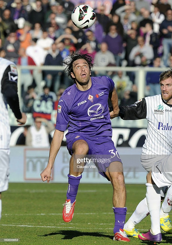 <a gi-track='captionPersonalityLinkClicked' href=/galleries/search?phrase=Luca+Toni&family=editorial&specificpeople=453307 ng-click='$event.stopPropagation()'>Luca Toni</a> of ACF Fiorentina #30 in action during the Serie A match between ACF Fiorentina and AC Chievo Verona at Stadio Artemio Franchi on March 3, 2013 in Florence, Italy.